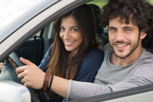 Smiling Couple Traveling By Car